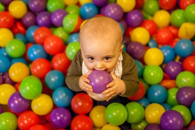 Little boy having fun in an indoor playground in an activity centre
