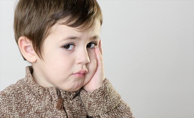 Beautiful Portrait of a sad little boy
